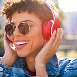 happy-african-woman-with-headphones-XHYEV5W